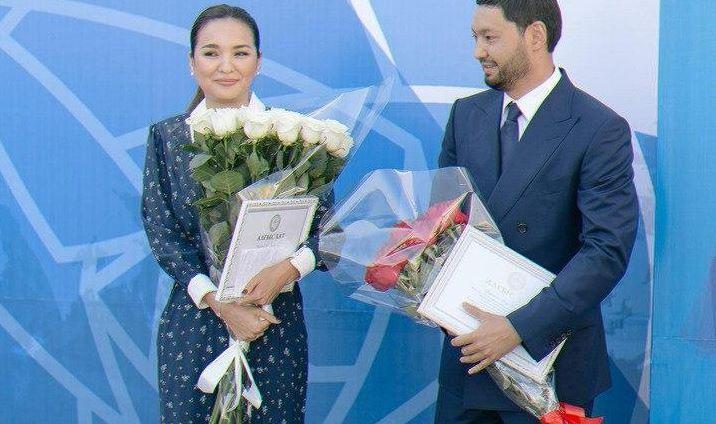 Aselle Tasmgambetova and Kenes Rakishev